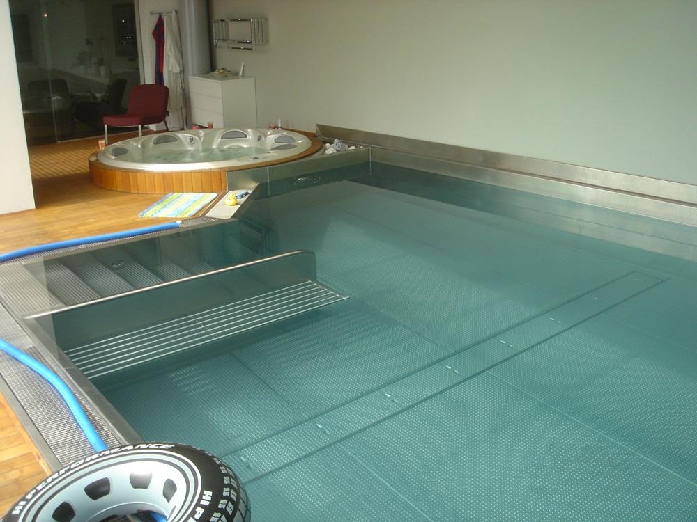 Nerezový interiérový bazén s přelivem 8,5x3,5 m a whirlpoolem Orion